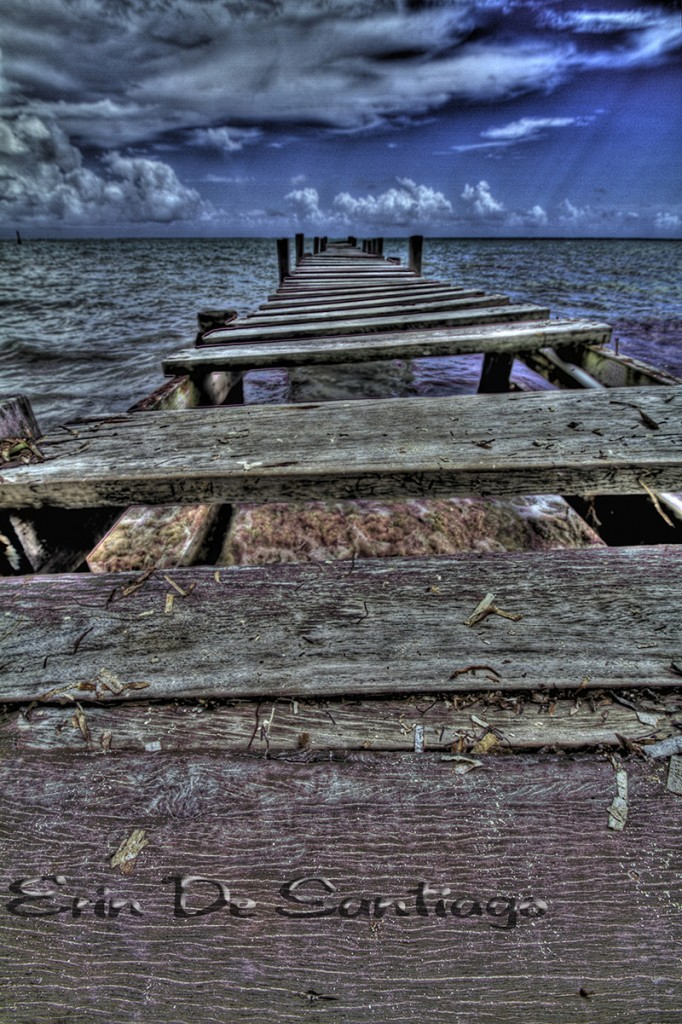 Hurricane damaged pier in Amgbergris Caye, Belize